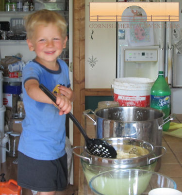 Caleb helps make the cheese